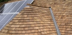 Roof with cedar shake shingles and solar panels