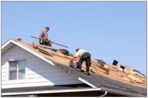 Men repairing a roof