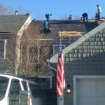 Complete roof tearoff including wood replacement.
