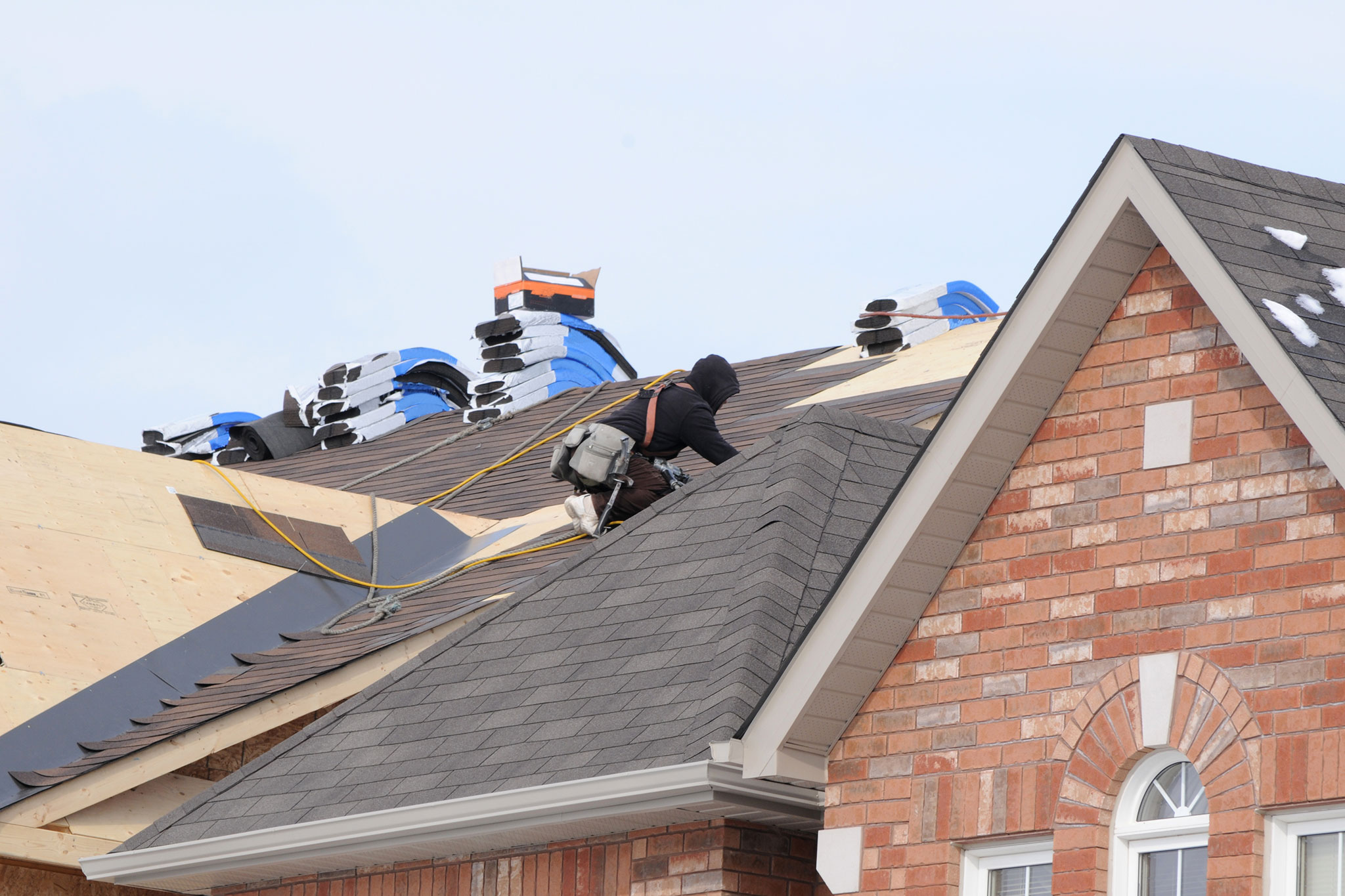 roofer on the job in warm clothing