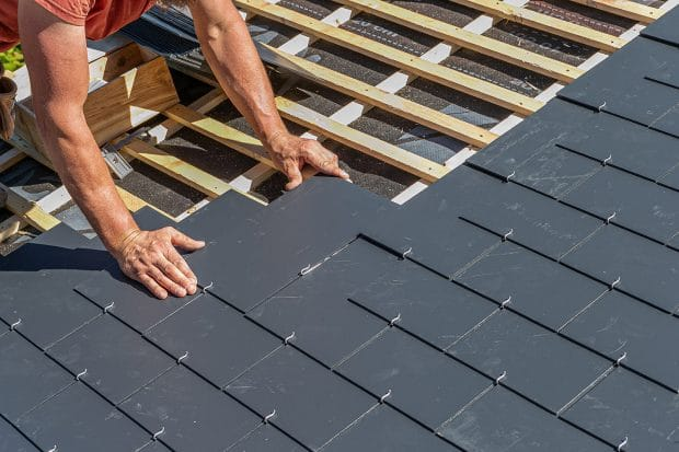 roofer installing slate shingles