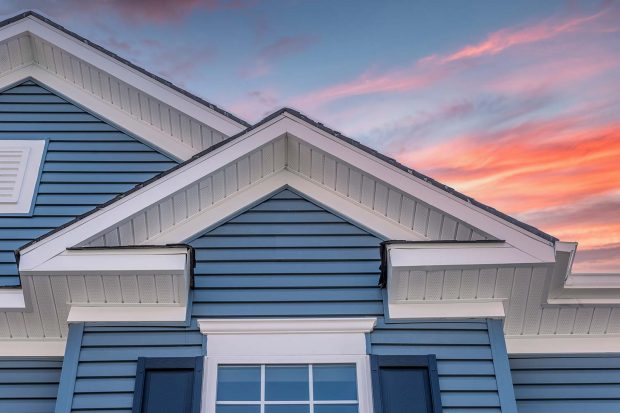 home with blue vinyl siding